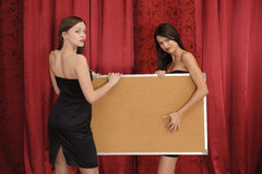 Girls hold empty board Stock Photos