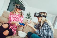 Girls hold modern devices, VR glasses. And inspect, study possibilities of gadget and communicate with each other royalty free stock photos