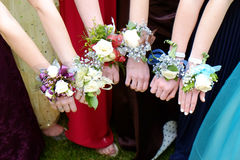 Girls Holding Arms Out with Corsage Flowers for Prom Stock Photography
