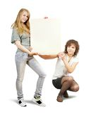Girls holding banner Royalty Free Stock Photography