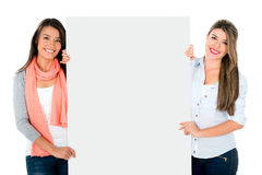Girls holding a banner Stock Photography
