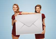 Girls holding big envelope Stock Photos