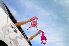 Girls holding bikini Royalty Free Stock Photography