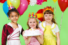 Girls holding birthday cake Stock Images