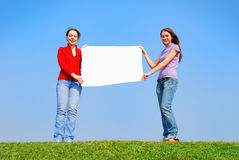 Girls holding blank sheet Stock Photography