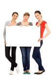 Girls holding blank sign. Three young girls holding blank sign Royalty Free Stock Photos