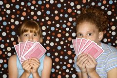 Girls holding cards. Royalty Free Stock Images