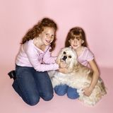 Girls holding Cocker Spaniel Royalty Free Stock Photos