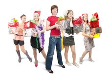 Girls holding coloured christmas gifts over white Royalty Free Stock Photos