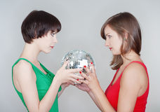 Girls holding a disco ball Stock Photo