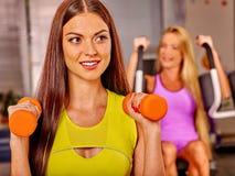 Girls holding dumbbells in sport gym Stock Images