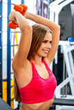 Girls holding dumbbells in sport gym Stock Photography