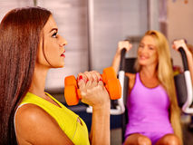 Girls holding dumbbells in sport gym Stock Photo