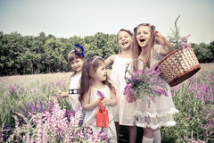 Girls  holding flower baskets Stock Photo