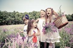 Girls  holding flower baskets Stock Photo