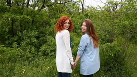 Girls holding hands. stock footage