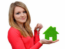 Girls holding in hands green house Royalty Free Stock Photography