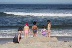 Girls holding hands at beach Royalty Free Stock Image