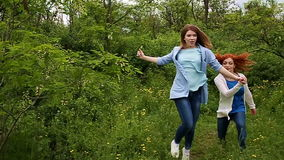 Girls holding hands and running. stock footage