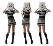 Girls holding happy and sad masks. Tree slender girls holding happy and sad face masks symbolizing changing emotions in studio over white background Stock Image