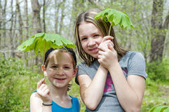 Girls holding May apples Royalty Free Stock Photography