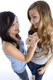 Girls holding microphone Royalty Free Stock Photos