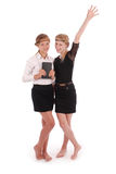 Girls holding tablet PCs lifting arm Royalty Free Stock Images