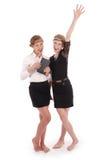 Girls holding tablet PCs lifting arm Royalty Free Stock Photo