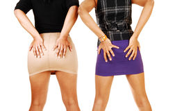 Girls holding there butt. Stock Image