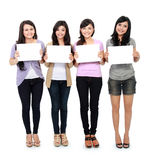 Girls holding white board Royalty Free Stock Photo