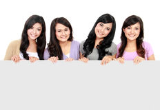Girls holding white board Stock Image