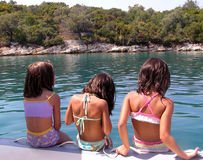 Girls on holidays in Greece. Little ladies gazing at the sea, summer is for children Stock Photography