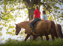 Girls on a horse Stock Photo