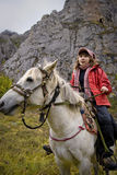 The girls on horseback Stock Image