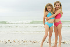 Girls hugging at the beach stock photo