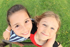Girls hugging. Little kids - smiling girls hugging each other stock images