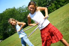 Girls with hula hoop Stock Images
