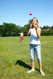 Girls with hula hoop and balls