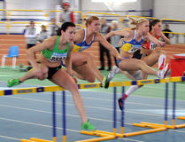 Girls on the hurdles race Royalty Free Stock Images