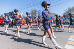 Girls in hussar form march with tags Stock Photography