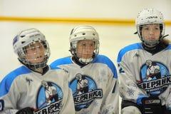 Girls ice hockey match. Children playing hockey on a city tournament St. Petersburg, Russia Stock Image