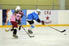 Girls ice hockey match. Children playing hockey on a city tournament St. Petersburg, Russia Stock Photos