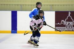 Girls ice hockey match. Children playing hockey on a city tournament St. Petersburg, Russia Stock Photo