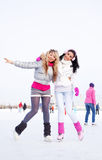 Girls ice skating Stock Photo