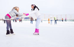 Girls ice skating Stock Image