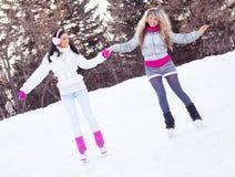 Girls ice skating Royalty Free Stock Image