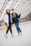 Girls on ice-skating rink Stock Photography