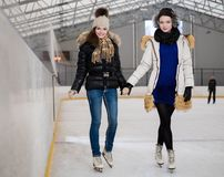 Girls on ice-skating rink Royalty Free Stock Photos