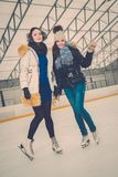 Girls on ice skating rink Royalty Free Stock Photo