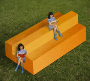 Girls and impossible timber. Stock Photo